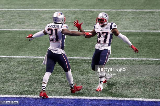 Duron Harmon and JC Jackson of the New England Patriots react in the second half against the Los Angeles Rams during Super Bowl LIII at MercedesBenz...