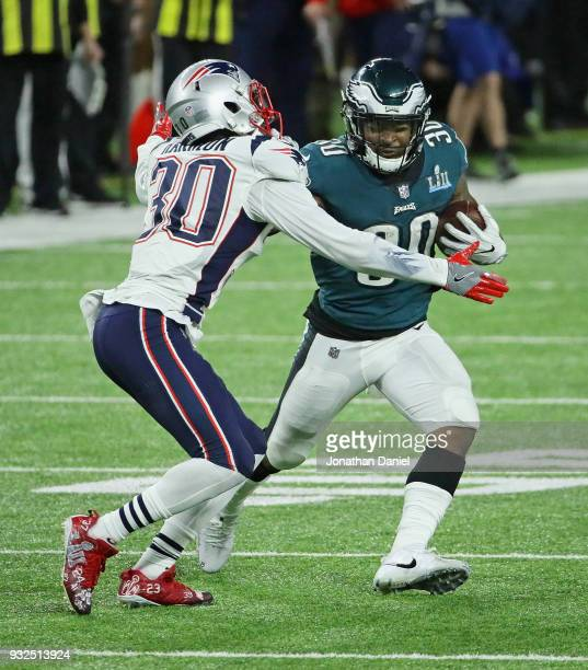 Duron Harmon of the New England Patriots grabs Corey Clement of the Philadelphia Eagles during Super Bowl Lll at US Bank Stadium on February 4 2018...