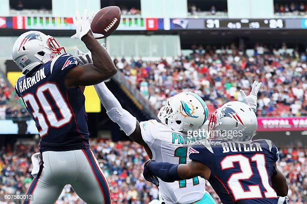 Duron Harmon of the New England Patriots intercepts a pass in the end zone during the fourth quarter against the Miami Dolphins at Gillette Stadium...