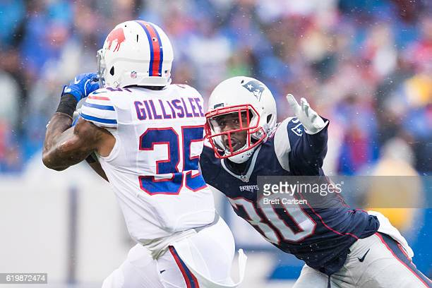 Duron Harmon of the New England Patriots tackles Mike Gillislee of the Buffalo Bills during the first half on October 30, 2016 at New Era Field in...