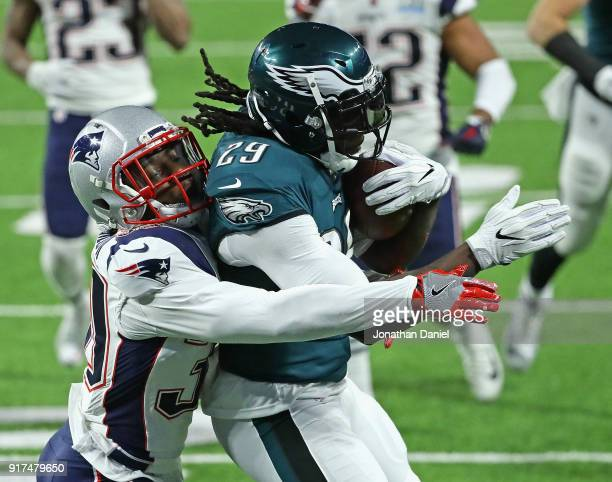 Duron Harmon of the New England Patriots tries to bring down LeGarrette Blount of the Philadelphia Eagles during Super Bowl Lll at US Bank Stadium on...
