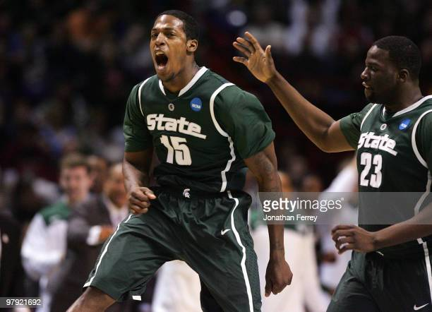 Durrell Summers of the Michigan State Spartans celebrates making a three point shot with teammate Draymond Green against the Maryland Terrapins...