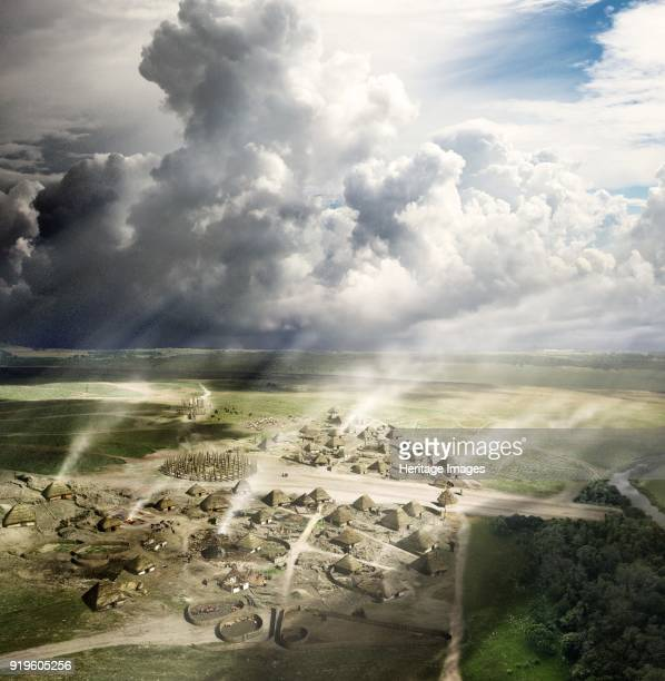 Durrington Walls Wiltshire circa 2500 BC Reconstruction showing the settlement near Stonehenge looking north in summer The image shows the timber...