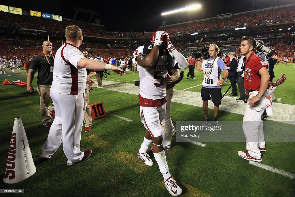 Durron Neal #5 of the Oklahoma Sooners reacts after the Clemson Tigers defeat the Oklahoma Sooners with a score of 37 to 17 in the 2015 Capital One Orange Bowl at Sun Life Stadium on December 31, 2015 in Miami Gardens, Florida.