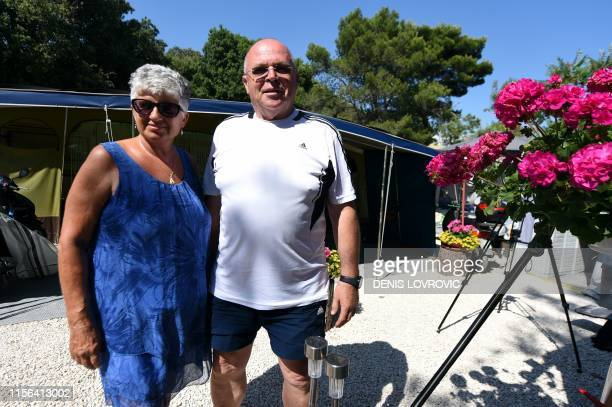 Dusan and Katarina Salomon a Slovenian couple who live in Germany and have visited Koversada for nearly 50 years pose on June 20 in front of their...