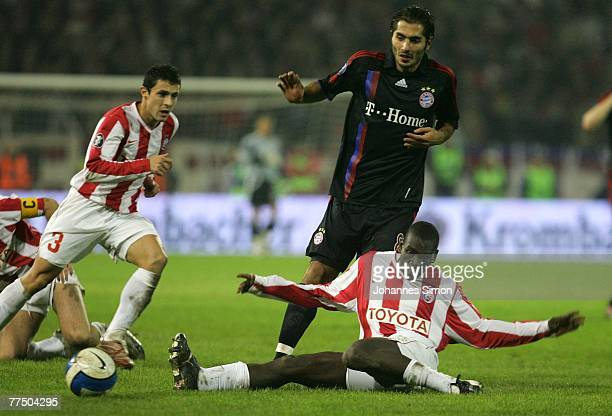 Dusan Andjelkovic and Gueye Ibrahima of Belgrade and Hamit Altintop of Bayern in action during the UEFA Cup group F match between Crvena Zvezda and...