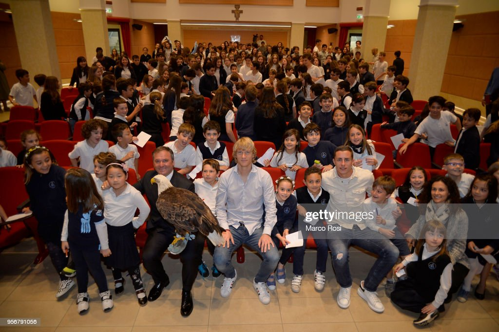 Dusan Basta and Adam Marusic of SS Lazio meet students during a visit to Asisium school on May 10, 2018 in Rome, Italy.