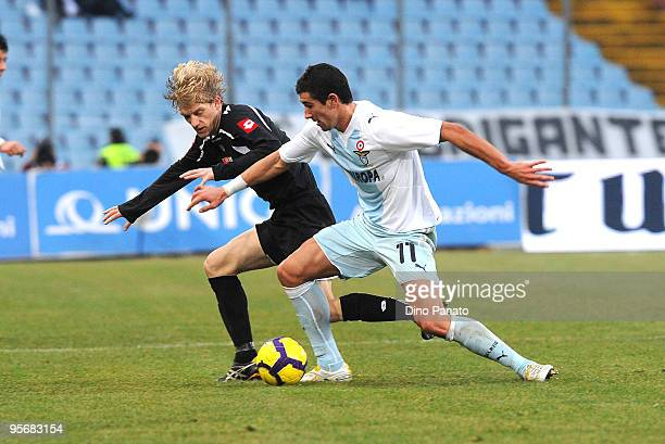 Dusan Basta of Udinese competes with Aleksandar Kolarov of Lazio during the Serie A match between Udinese and Lazio at Stadio Friuli on January 10...