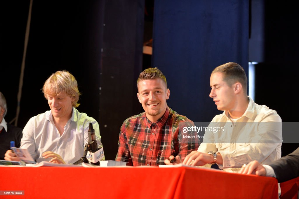 Dusan Basta, Sergej Milinkvoic Savic and Adam Marusic of SS Lazio meet students during a visit to Asisium school on May 10, 2018 in Rome, Italy.