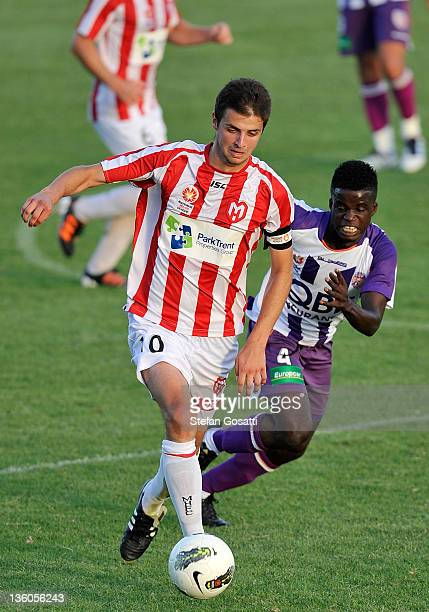 Dusan Bosnjak of the Heart and Blamo Quaqua of the Glory compete for the ball during the round nine Youth League match between the Perth Glory and...