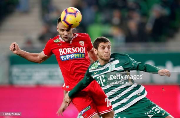 Dusan Brkovic of DVTK heads the ball next to Lasha Dvali of Ferencvarosi TC during the Hungarian OTP Bank Liga match between Ferencvarosi TC and DVTK...