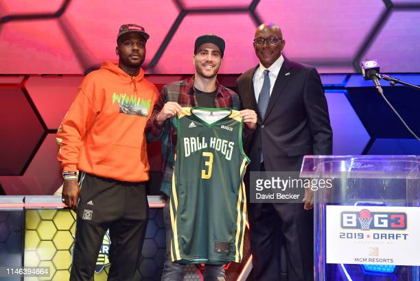 Dusan Bulut poses with Ball Hogs cocaptain DeShawn Stevenson and BIG3 Commissioner Clyde Drexler after being drafted at by the Ball Hogs in the third...