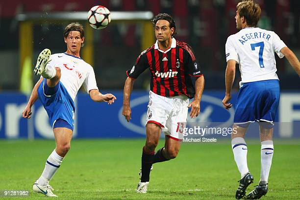 Dusan Djuric of Zurich controls the ball as Alessandro Nesta looks on during the UEFA Champions League Group C match between AC Milan and FC Zurich...