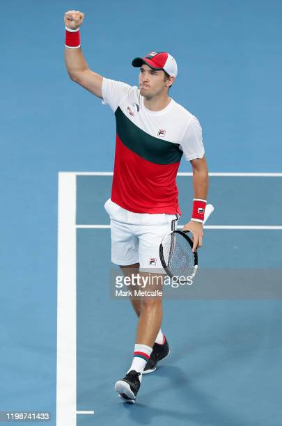 Dusan Lajović of Serbia celebrates winning set point during his semi-final singles match against Karen Khachanov of Russia during day nine of the...
