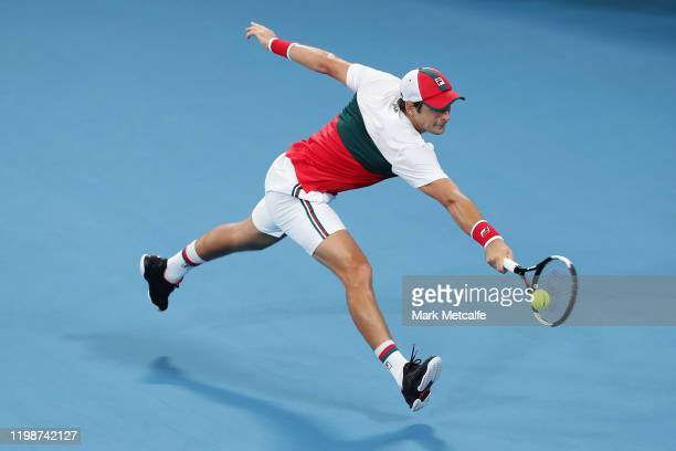 Dusan Lajović of Serbia plays a backhand during his semi-final singles match against Karen Khachanov of Russia during day nine of the 2020 ATP Cup at...