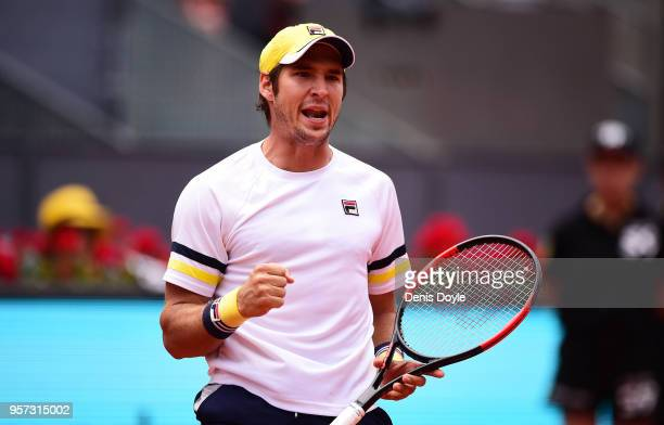 Dusan Lajovic of Serbia celebrates after winning a point against Kevin Anderson of South Africa during their Quarterfinal match in day seven of Mutua...