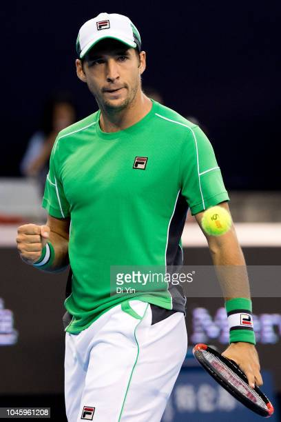 Dusan Lajovic of Serbia celebrates against Kyle Edmund of Great Britain during his Men's Singles Quarterfinals match of the 2018 China Open at the...