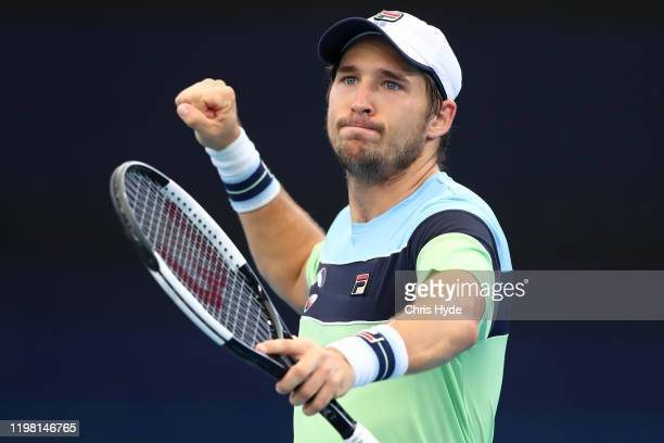 Dusan Lajovic of Serbia celebrates winning his match against Nicolas Jarry of Chile during day six of the 2020 ATP Cup Group Stage at Pat Rafter...