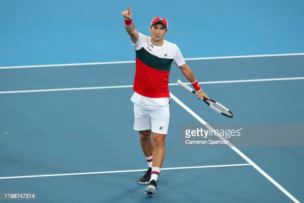 Dusan Lajovic of Serbia celebrates winning match point during his semi-final singles match against Karen Khachanov of Russia on day nine of the 2020...