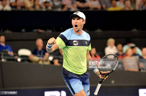 Dusan Lajovic of Serbia celebrates winning the second set in his match against Llyod Harris of South Africa during day two of the 2020 ATP Cup Group...
