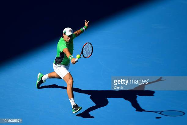 Dusan Lajovic of Serbia hits a return against Grigor Dimitrov of Bulgaria during their Men's Singles 2nd Round match of the 2018 China Open at the...