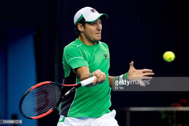 Dusan Lajovic of Serbia hits a return against Kyle Edmund of Great Britain during his Men's Singles Quarterfinals match of the 2018 China Open at the...