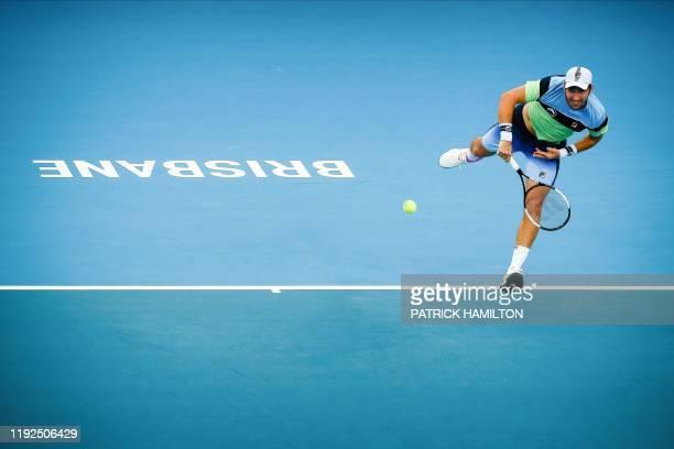 Dusan Lajovic of Serbia hits a return against Nicolas Jarry of Chile during the men's singles match on day six of the ATP Cup tennis tournament in...