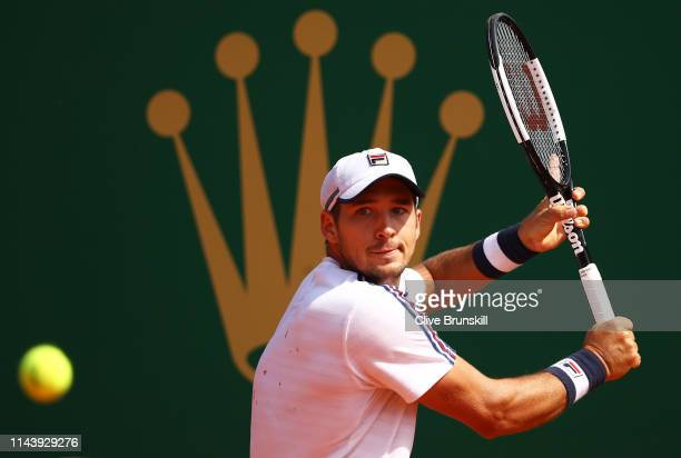 Dusan Lajovic of Serbia plays a backhand against Daniil Medvedev of Russia in their semifinal match during day seven of the Rolex MonteCarlo Masters...