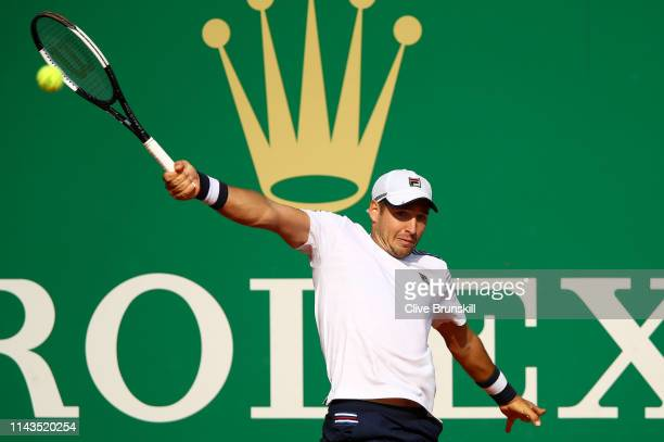 Dusan Lajovic of Serbia plays a backhand against Dominic Thiem of Austria in their third round match during day five of the Rolex MonteCarlo Masters...