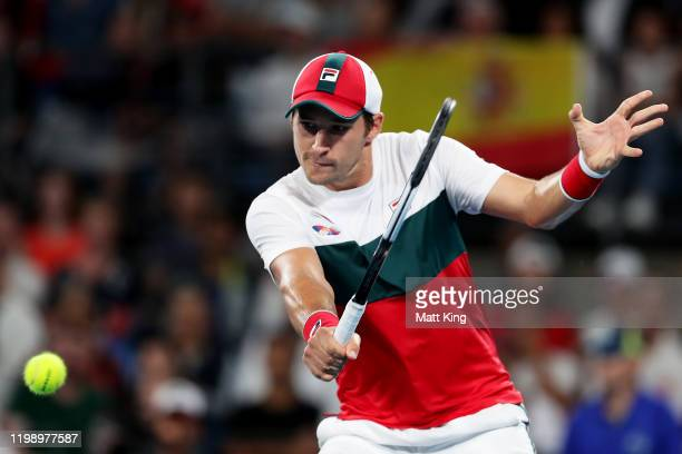 Dusan Lajovic of Serbia plays a backhand during his final singles match against Roberto Bautista Agut of Spain during day 10 of the ATP Cup at Ken...
