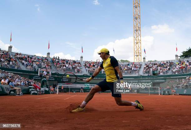 Dusan Lajovic of Serbia plays a backhand during the mens singles second round match against Alexander Zverev of Germany during day four of the 2018...