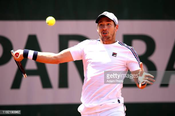 Dusan Lajovic of Serbia plays a forehand during his mens singles first round match against Thiago Monteiro of Brazil during Day three of the 2019...