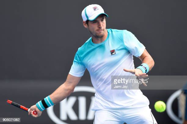 Dusan Lajovic of Serbia plays a forehand in his first round match against Diego Schwartzman of Argentina on day one of the 2018 Australian Open at...