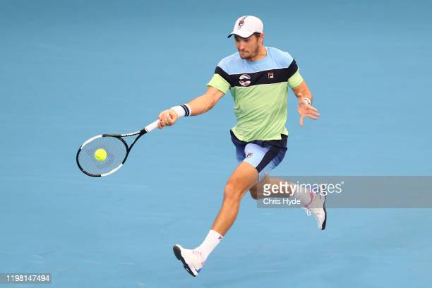 Dusan Lajovic of Serbia plays a forehand in his match against Nicolas Jarry of Chile during day six of the 2020 ATP Cup Group Stage at Pat Rafter...