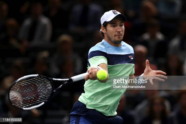 Dusan Lajovic of Serbia returns a forehand to Corentin Moutet of France on day 2 of the Rolex Paris Masters, part of the ATP World Tour Masters 1000...