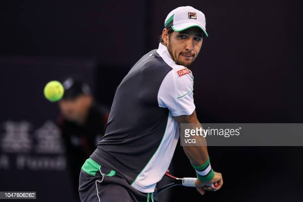 Dusan Lajovic of Serbia returns a shot in the Men's Singles first round match against Vasek Pospisil of Canada on day three of the 2018 China Open at...