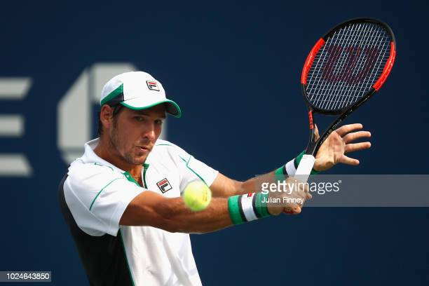 Dusan Lajovic of Serbia returns the ball in his mens singles first round match against Damir Dzumhur of Bosnia and Herzegovina on Day One of the 2018...