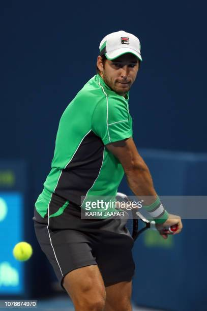 Dusan Lajovic of Serbia returns the ball to Marco Cecchinato of Italy during their ATP Qatar Open tennis quarterfinal match in Doha on January 3 2019