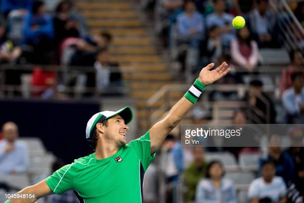 Dusan Lajovic of Serbia serves to Kyle Edmund of Great Britain during his Men's Singles Quarterfinals match of the 2018 China Open at the China...