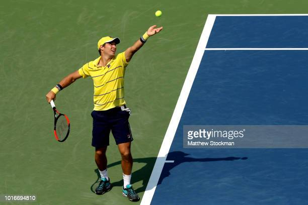 Dusan Lajovic of Serbia serves to Milos Roanic of Canada during the Western Southern Open at Lindner Family Tennis Center on August 14 2018 in Mason...