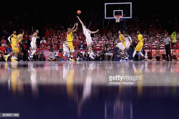 Dusan Ristic of the Arizona Wildcats and Kingsley Okoroh of the California Golden Bears jump for a rebound during the second half of the college...
