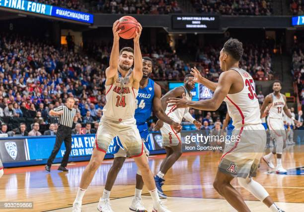 Dusan Ristic of the Arizona Wildcats pulls down a rebound during the NCAA Division I Men's Championship First Round game between the Arizona Wildcats...