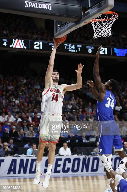 Dusan Ristic of the Arizona Wildcats shoots the ball against Ikenna Smart of the Buffalo Bulls during the first round of the 2018 NCAA Men's...