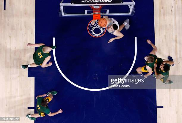 Dusan Ristic of the Arizona Wildcats watches a shot fall during the first half of the college basketball game against the North Dakota State Bison at...
