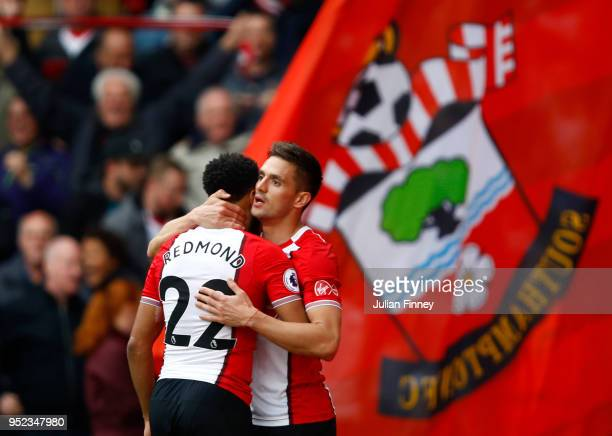 Dusan Tadic celebrates scoring his side's first goal with Nathan Redmond of Southampton during the Premier League match between Southampton and AFC...