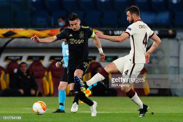 Dusan Tadic of Ajax and Bryan Cristante of AS Roma during the UEFA Europa League Quarter Final: Leg Two match between AS Roma and Ajax at Stadio...