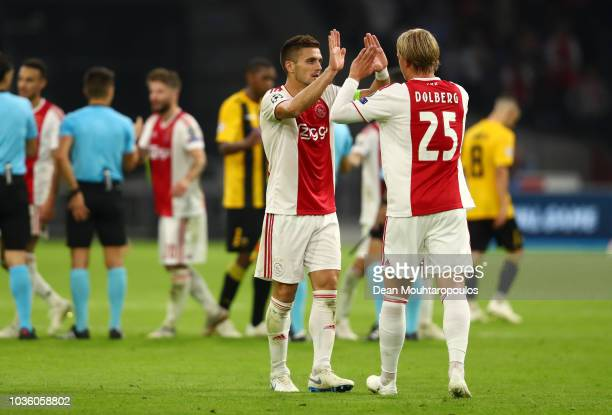 Dusan Tadic of Ajax and Kasper Dolberg of Ajax celebrate victory after the Group E match of the UEFA Champions League between Ajax and AEK Athens at...