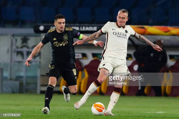 Dusan Tadic of Ajax and Rick Karsdorp of AS Roma during the UEFA Europa League Quarter Final: Leg Two match between AS Roma and Ajax at Stadio...