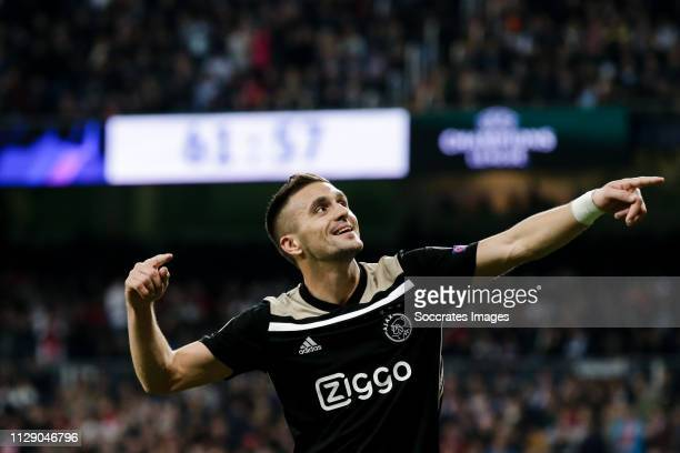 Dusan Tadic of Ajax celebrates 03 during the UEFA Champions League match between Real Madrid v Ajax at the Santiago Bernabeu on March 5 2019 in...