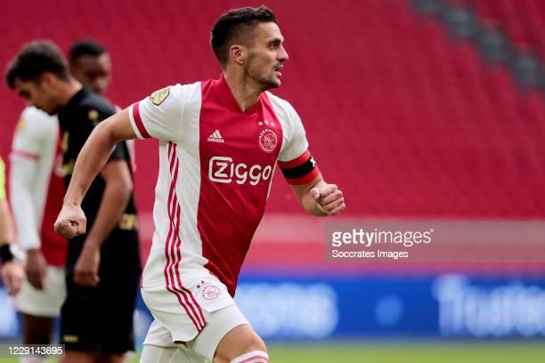 Dusan Tadic of Ajax celebrates 1-0 during the Dutch Eredivisie match between Ajax v SC Heerenveen at the Johan Cruijff Arena on October 18, 2020 in...